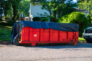 A 20-Yard Dumpster Rental sitting in front of a client's house.